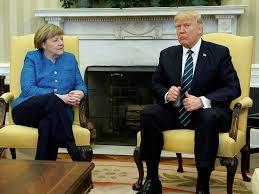 trump and merkel don u0027t shake hands during awkward interaction