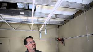Drop Ceiling Installation by Vertical Acoustical To Drywall Transition Molding Installation