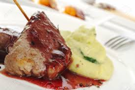 Potatoes Main Dish - main dish meat with red pepper sauce and mashed potatoes