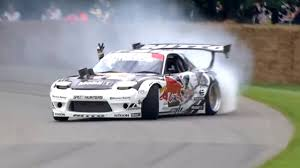 mazda rx7 drift mad mike drifting the red bull rx7 up the goodwood hill climb