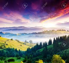 majestic mountain landscape with colorful cloud dramatic overcast