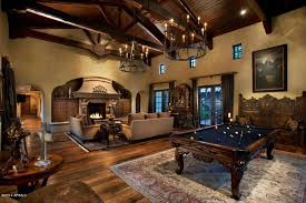 traditional living room with chandelier u0026 stone fireplace in