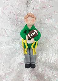 this flag football christmas ornament is the perfect gift for your