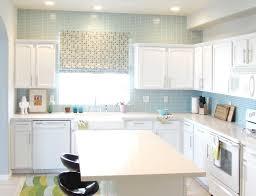 blue glass tile kitchen backsplash modern white l shape wooden kitchen cabinet connected kitchen