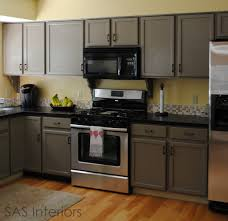 Refinishing Melamine Kitchen Cabinets by Painting Laminate Kitchen Cabinets How To Paint Laminate Cabinets