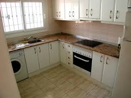fascinating apartment kitchen design ideas with cream ceramic fascinating apartment kitchen design ideas with cream ceramic floor and white kitchen cabinet also brown marble countertop