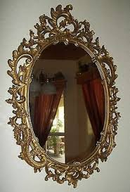23 in x 28 in bronze oval framed mirror oval frame and