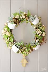 spring a warm welcome with 18 flowery diy wreaths