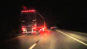 led lights for semi trucks allowing big semi truck with lots of led lights to cut over infront