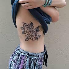30 flowers tattoos on side rib