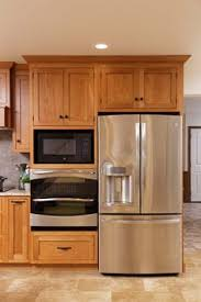 Kitchen Cabinets Faces by This Tall Microwave And Oven Cabinet Follows The Current Trend To