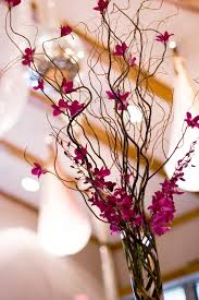 curly willow centerpieces the autumn wedding curly willow branches with orchid centerpieces