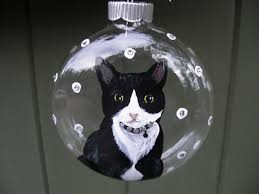 painted glass ornament with tuxedo cat