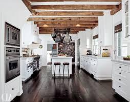 nice looking white kitchen cabinets with dark hardwood floors