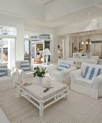 chic bright and airy living room in all white furniture and