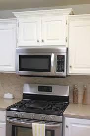 oak wood red shaker door kitchen cabinet crown molding backsplash