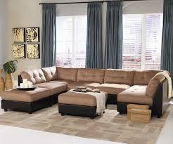interior furniture mocha fabric sectional sofa set on beige rug