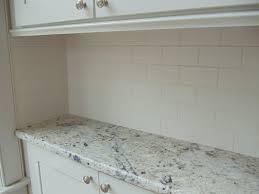 white glass subway tile kitchen backsplash damaged cabinets
