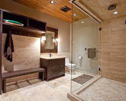 bathroom glass shower door and beige colored ceramic tiles for