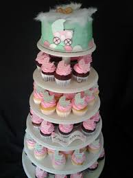 its a pink and green baby buggy baby shower cake and