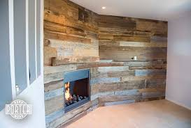reclaimed oak mantel and tobacco barn wood wall covering porter