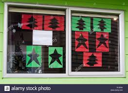 exterior christmas decorations cut out of red and green paper of