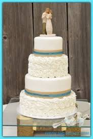 sweet and simple 4 tier wedding cake with sugar flowers wedding