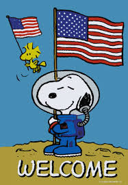 snoopy and woodstock landing on the moon and holding american