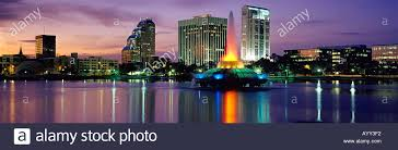 cityscape backdrop with glowing sunset as backdrop downtown orlando fl is reflected