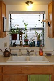 Christmas Decorating Ideas For The Kitchen by Kitchen Style Elegant Kitchen Window With Christmas Decoration