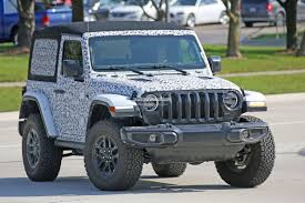 light blue jeep wrangler 2 door spyshots 2018 jeep wrangler jl reveals grille and headlights