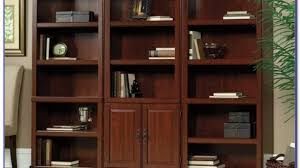 library bookcase with doors intended for desire living room
