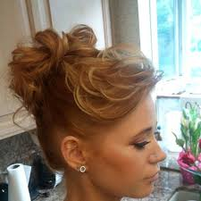 curly hair in high bun with bang stylish bun hairstyle for curly hair styles weekly