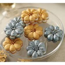 top your spritz cookies with a metallic candy snowflake use candy