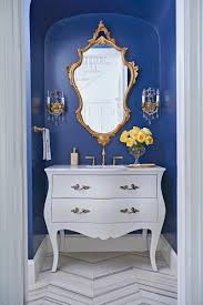 cobalt blue paint gives this tiny powder room and its marble