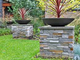 modern low bowl planters on stone columns ddladesign planters