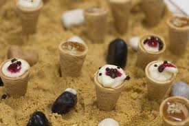 edible sand seaside themed canapes for office opening party in whitstable