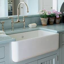 what s trending in kitchen sinks and fixtures pb kitchen design shaws fireclay sink by rohl