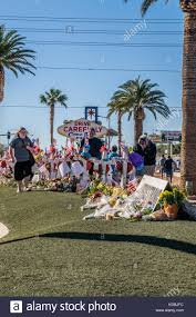 people pay respects at the line of crosses set up at the welcome