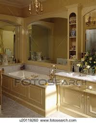 stock photography of large mirror above bath in traditional cream