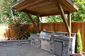 back yard kitchen ideas rustic patio with outdoor kitchen by all oregon landscaping