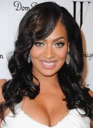 pic of black women side swept bangs and bun hairstyle high glamour glossy black waves with side swept bangs la la