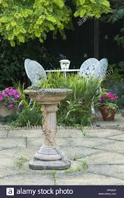 Small Urban Gardens Small Urban Garden With Patio Bird Bath And Chairs And Tables Uk