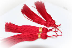 set of four red tassels for crafts holiday projects christmas