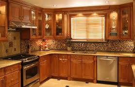 oak and white kitchen cabinets dark brown kitchen counter polished