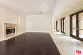 living room living room marble the half wood half marble floors in the living room make for a