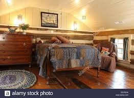 log cabin floors log cabin attic bedroom with exposed logs and hardwood floors usa