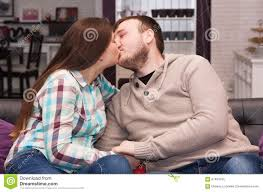 where to buy free hug sofa young couple kissing at home stock image image of reconciliation