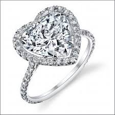 heart shaped wedding rings stardust design this beautiful heart shaped diamond set in a halo