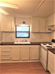 how to update mobile home kitchen cabinets mobile home makeover on a budget with new lights flooring